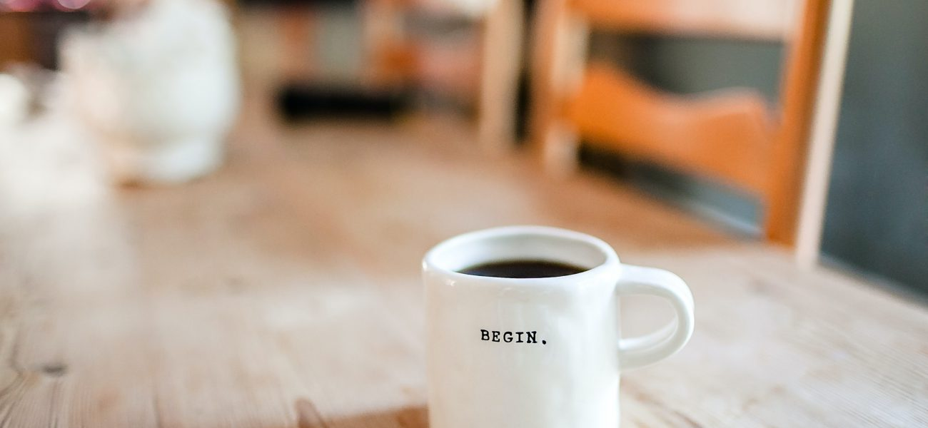 The word begin on a mug. symbolizes social entrepreneurship.