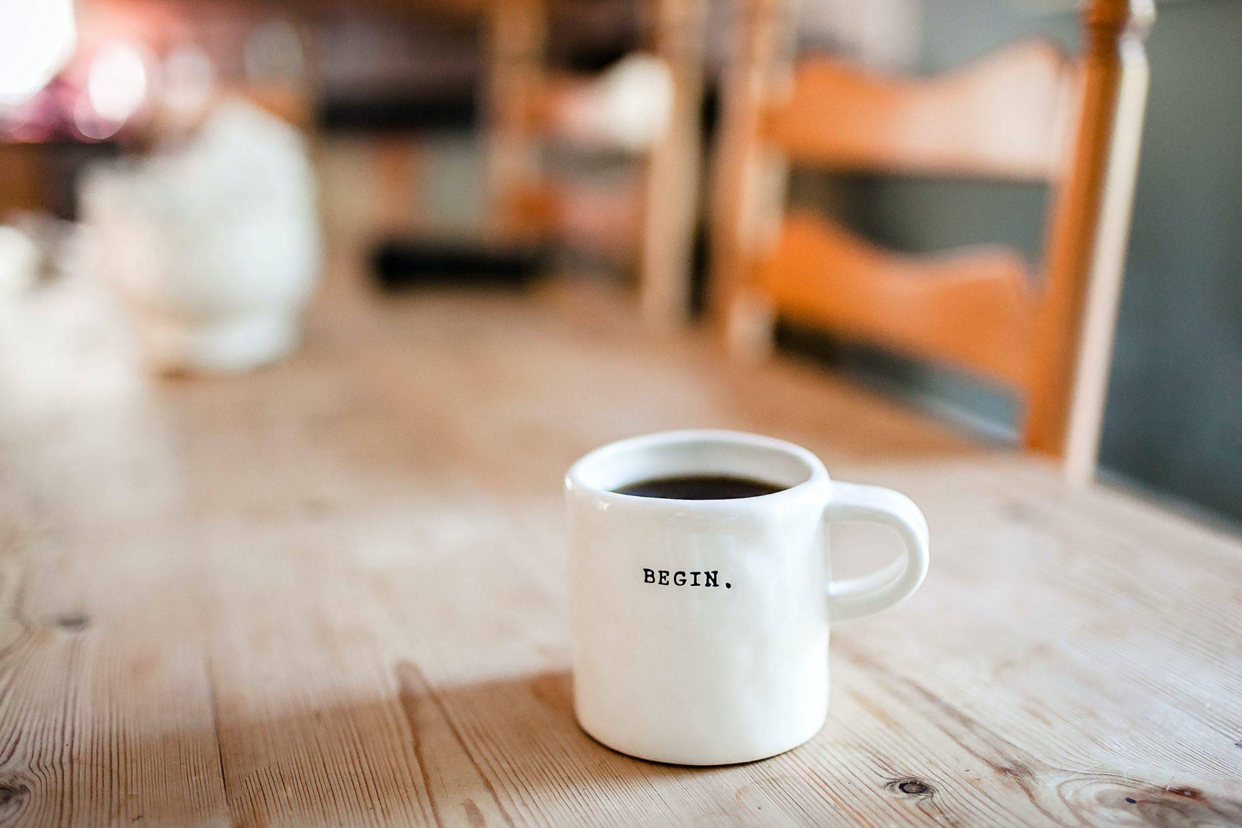 The word begin on a mug. symbolizes social entrepreneurship.