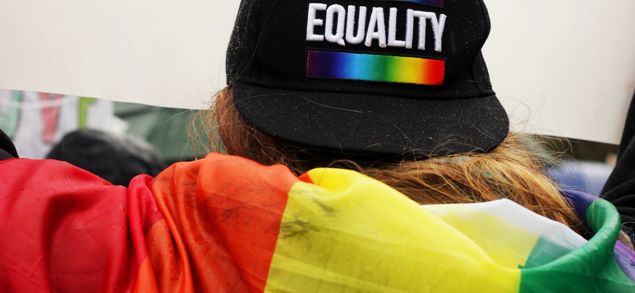 "person with a hat that says ""equality"""